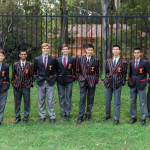 Junior and senior students modelling correct wearing of uniform