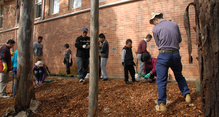 Parents and Students working on Grounds Day