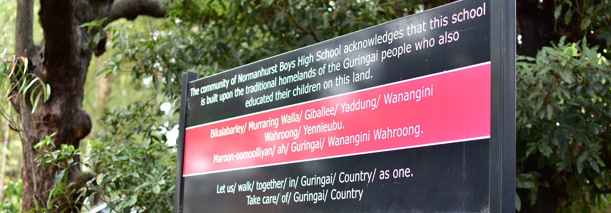 Sign acknowledging the traditional owners of the land on which Normanhurst Boys High School resides.